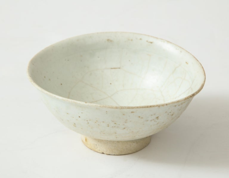 Fine footed porcelain carved Monk's Celadon tea bowl with organic shape, attributed to the Chosen period, Korea.