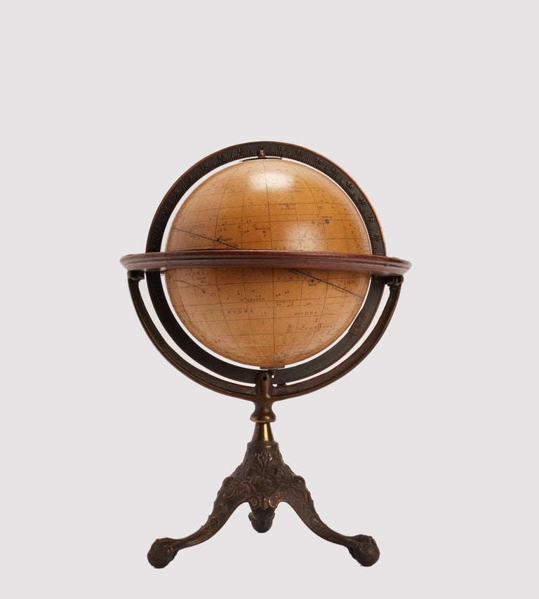 American paper mâché celestial globe, wooden horizon circle, cast iron tripod. Showing the positions of the principal stars and circles, by John Duncan, professor of astronomy, maker: Rand Mc. Nelly and co. USA, circa 1900.