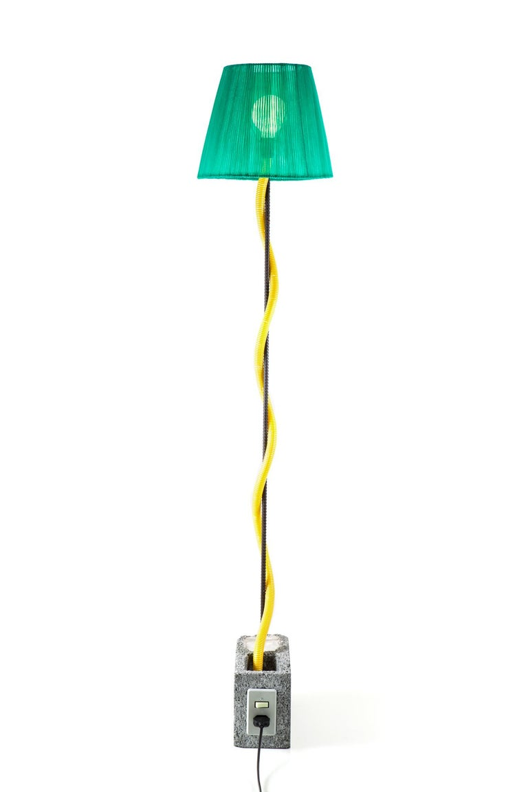 Floor lamp made from materials used in civil construction.