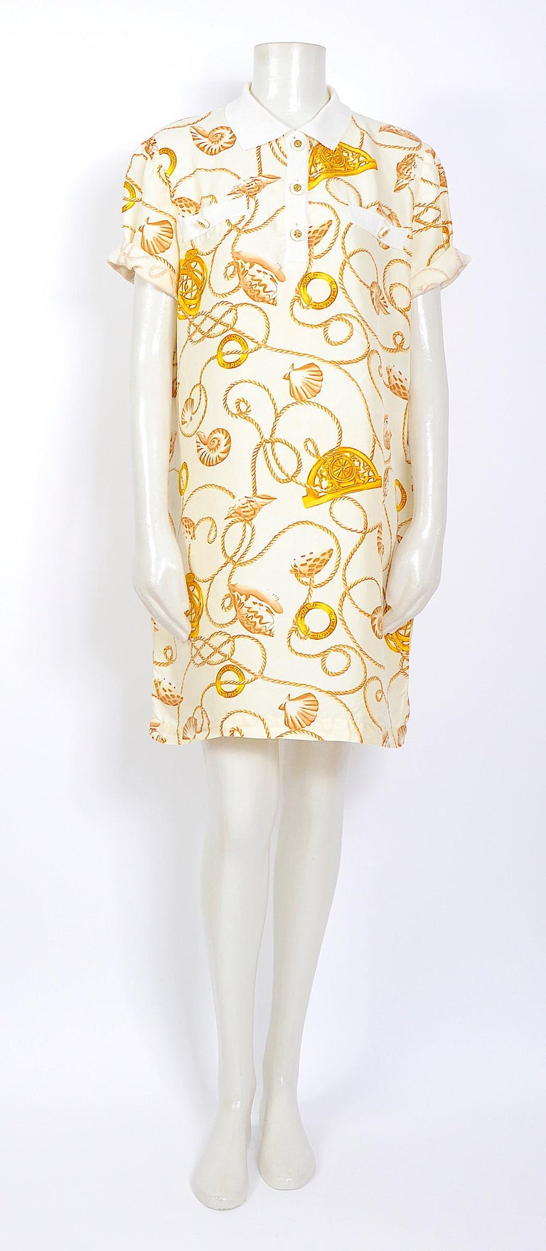 Beautiful Celine 1980s gold cord and logo print on a creme silk dress,  White & gold Celine signature buttons - 100%silk - unlined. Made in Italy - Italian size 46 - but could be worn oversize style, our doll is a french size 36., please use the