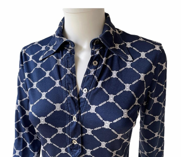 CELINE, Made in Italy, circa 70's. Blue crepe de chine long sleeves shirt with a classical collar. The famous Triomphe logo is printed in all-over.  There is no size tag but it fits Extra Small. Please see measurements bellow, taken flat and