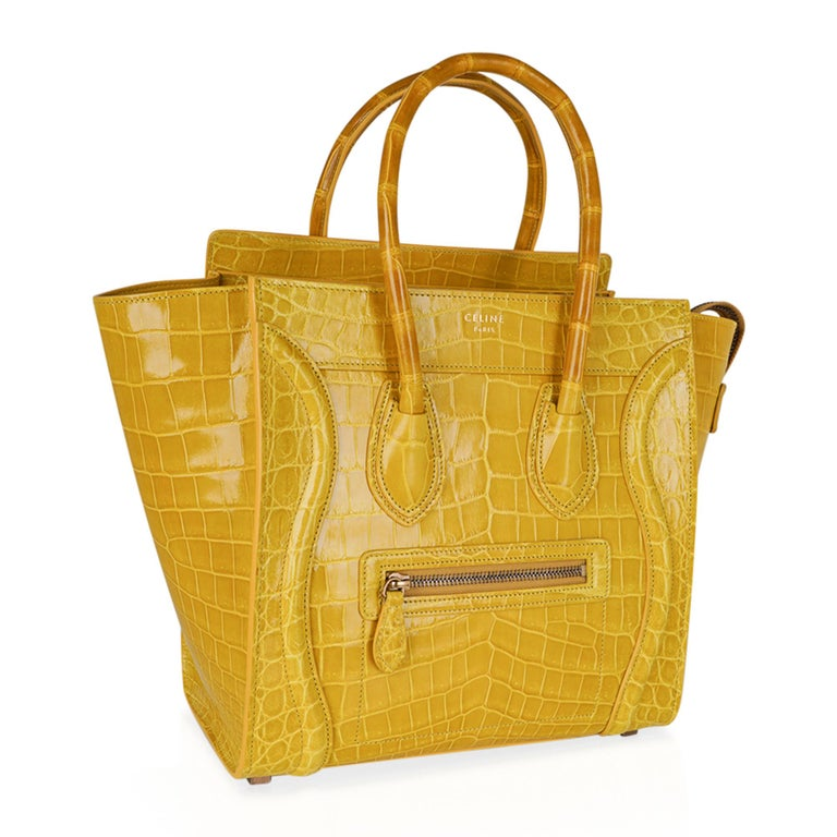 Guaranteed authentic Celine Yellow Micro Luggage tote featured in rare Yellow Crocodile skin. An iconic beauty and one of the most sought after bags. Zip top with 2 interior slot pockets and 1 zip pocket. 1 exterior zip pocket. 4 metal feet. CELINE