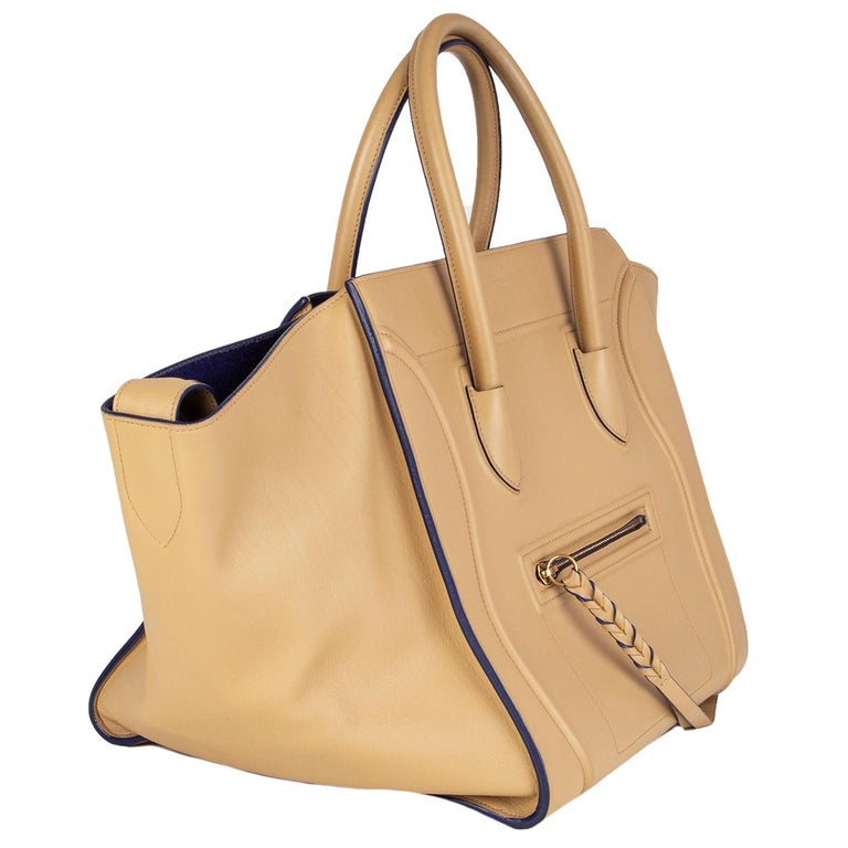 Céline 'Medium Luggage Phantom' tote bag in sand calfskin featuring a small zip front pocket. Lined in royal blue suede with one zipper pocket against the back. Has been carried with some faint darkening to the corners. Overall condition is
