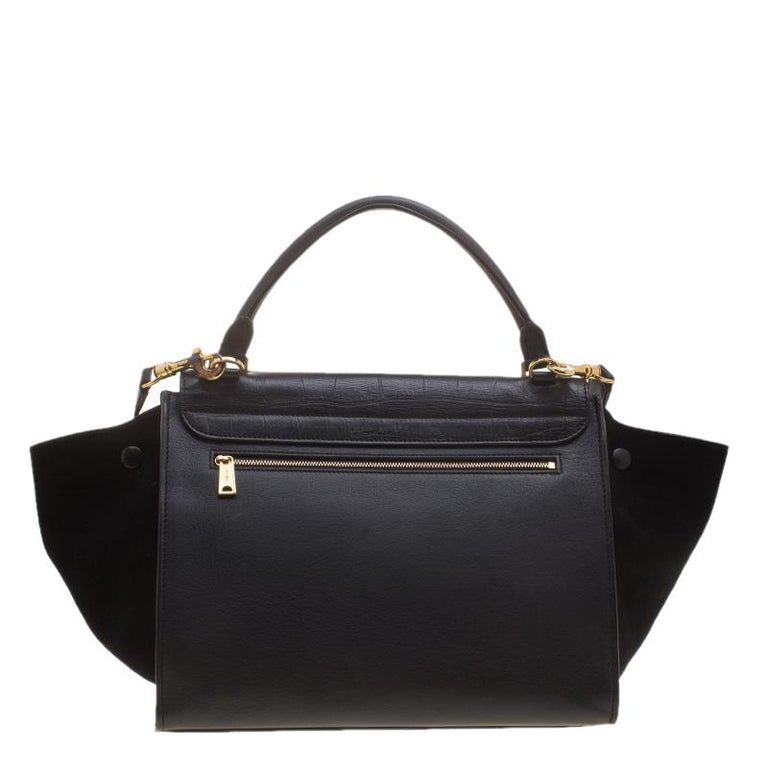 Pair this stylish leather and suede Celine bag with slim fitting pants and nude pumps. The interior has protective leather which keeps it steady. This might be your soon to be companion.  Includes:Original Dustbag, Info Booklet