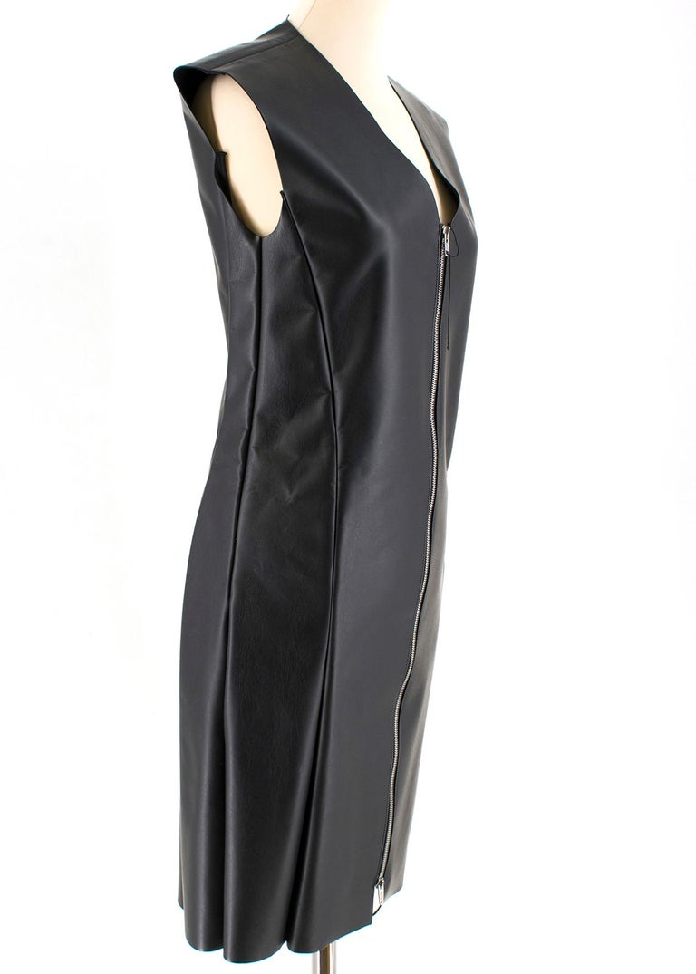 Celine Black Faux Leather Sleeveless Exposed Zip Front Dress  - Faux leather black dress - Shift style - Knee length - Exposed zip closure to the front - Silver tone hardware  - V neckline  - Sleeveless - Lind with viscose   Please note, these items