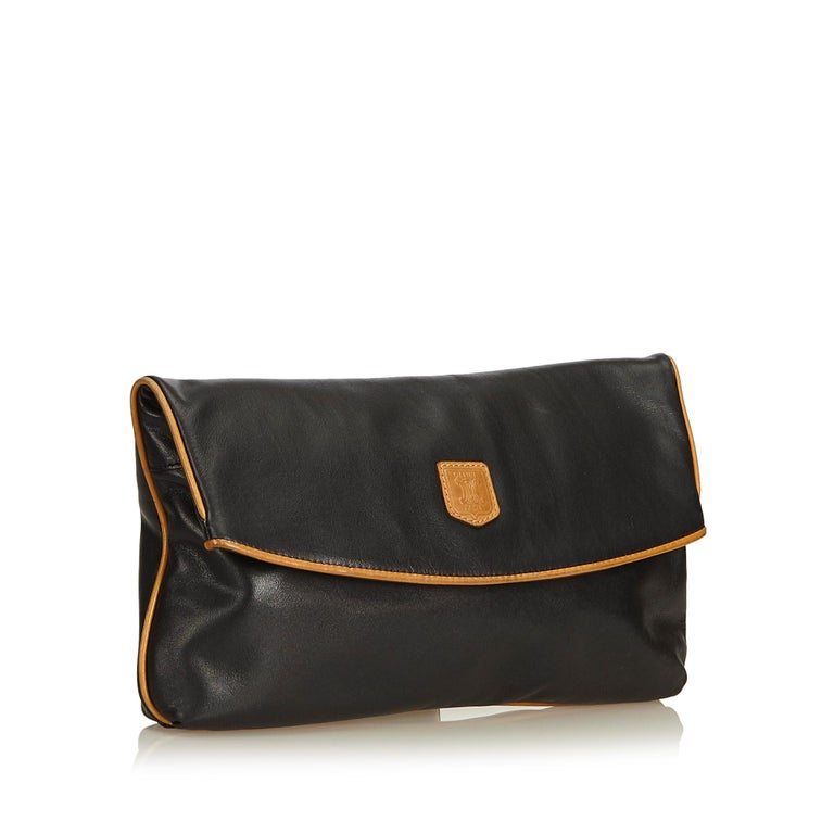 This clutch bag features a leather body, fold over top with button clasp closure, and an interior zip pocket. It carries as B+ condition rating.  Inclusions:  Dust Bag  Dimensions: Length: 16.00 cm Width: 30.00 cm Depth: 3.00 cm  Material: Leather x