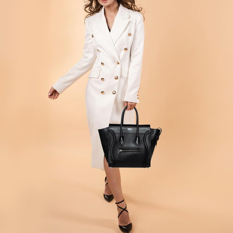The Luggage tote from Céline is one of the most popular handbags in the world. This tote is crafted from leather and designed in a black shade. It comes with rolled top handles and a front zip pocket. The bag is equipped with a well-sized Alcantara