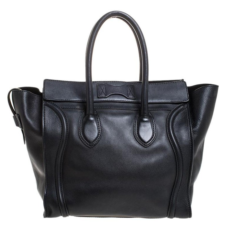 The Mini Luggage tote from Celine is one of the most popular handbags in the world. This tote is crafted from leather and designed in a black shade. It comes with rolled top handles and a front zip pocket. The bag is equipped with a well-sized