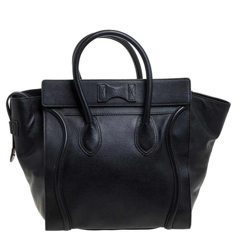 The mini Luggage tote from Celine is one of the most popular handbags in the world. This tote is crafted from leather and designed in a black shade. It comes with rolled top handles, a detachable shoulder strap and a front zip pocket. The bag is