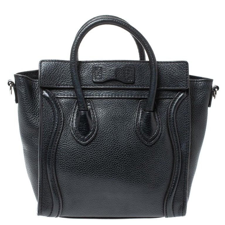 The Nano Luggage tote from Celine is one of the most popular handbags in the world. This tote is crafted from leather and designed in a black shade. It comes with rolled top handles, a detachable shoulder strap, and a front zip pocket. The bag is