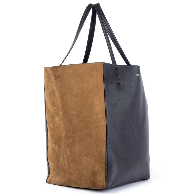 100% authentic Céline Horizontal Cabas Phantom Medium tote bag in black calfskin and olive green nubuck leather. Lined in black calfskin with one zipper pocket against the back and two open pockets on top. Comes with a detachable black calfskin