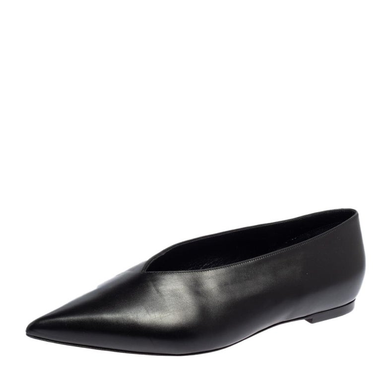 You are sure to fall head over heels in love with this pair of V Neck pumps from Celine. The exterior of these sandals has been crafted from leather and is designed with a V-shaped cut at the vamps. They feature pointed toes and leather