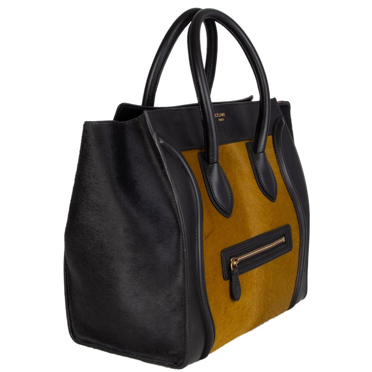 Céline 'Mini Luaggabe' tote in olive calf hair with black calf hair gussets and black leather details. Zipper pocket on the front. Closes with a zipper on top. Lined in black leather with two open pockets against front and a zipper pocket against