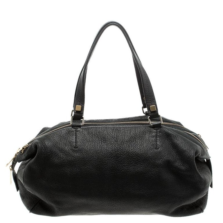Stunning to look at and durable enough to accompany you wherever you go, this Celine satchel is a joy to own! This Triple Zip bag is crafted from leather, with two top handles and three zippers on the top. The insides are fabric lined and perfectly