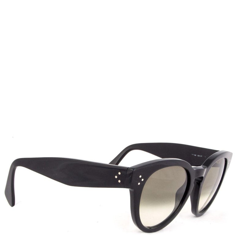 100% authentic Céline 'Thin Preppy' sunglasses in black acetate with grey-olive greenish gradient lenses. Have been worn and have small scratches allover the lenses. Overall in good condition. Come with soft case.   ModelCL-41049 807/XM Width15cm