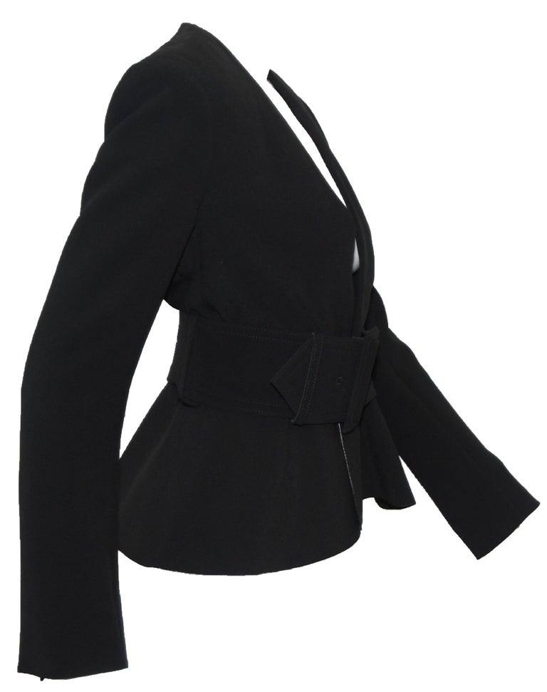 Celine's celebrated classic, minimalist and clean lines have made Pheobe Philo a household name.  Staying true to her initial ideology of polished pieces, this belted, peplum jacket incorporates a 3.50