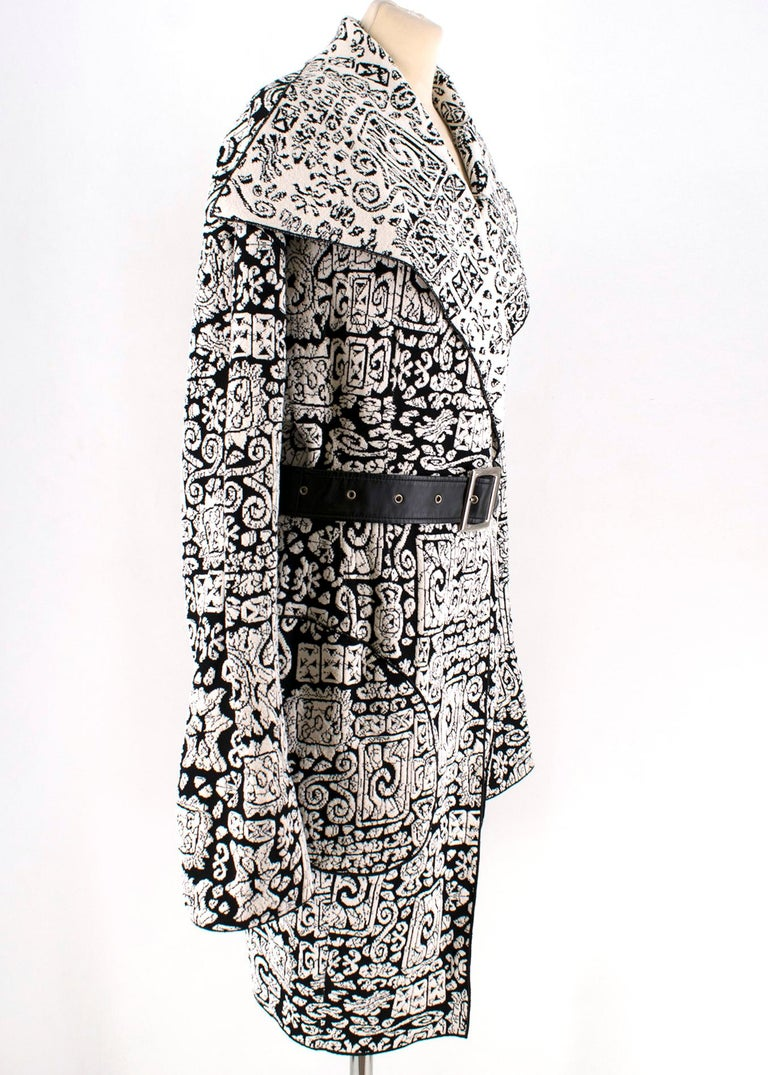 Celine Black & White Knitted Jacquard Coat  -  Black & White Long Sleeve Wrap Coat - Wrap style front - Leather-effect waist belt  - Jacquard Motifs - Mid-weight   Please note, these items are pre-owned and may show some signs of storage, even when