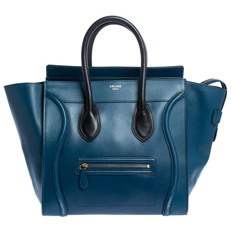 The mini Luggage tote from Celine is one of the most popular handbags in the world. This tote is crafted from leather and designed in a blue shade. It comes with rolled top handles and a front zip pocket. The bag is equipped with a well-sized