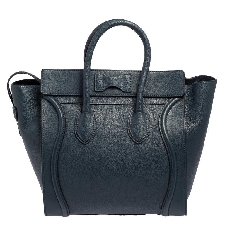 The mini Luggage tote from Celine is one of the most popular handbags in the world. This tote is crafted from leather and designed in a blue shade. It comes with rolled top handles and a front zip pocket. The bag is equipped with a well-sized fabric