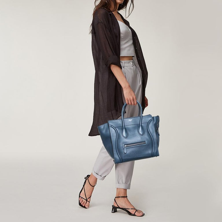 The Luggage tote from Céline is one of the most popular handbags in the world. This tote is crafted from leather and designed in a blue shade. It comes with rolled top handles, distinctive wavy lines, and a front zip pocket. The bag is equipped with