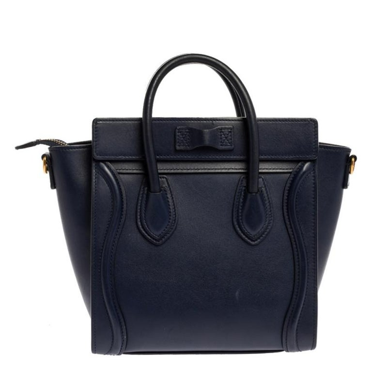The Nano Luggage tote from Celine is one of the most popular handbags in the world. This tote is crafted from leather and designed in a blue shade. It comes with rolled top handles, a detachable shoulder strap and a front zip pocket. The bag is