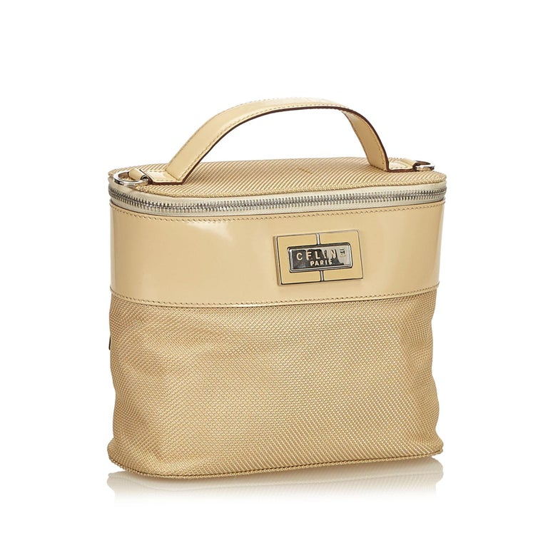 This vanity bag features a chemical fiber and patent leather body, detachable shoulder strap, wraparound zip closure, and an internal slip pocket. It carries as B+ condition rating.  Inclusions:  Dust Bag  Dimensions: Length: 17.00 cm Width: 22.00