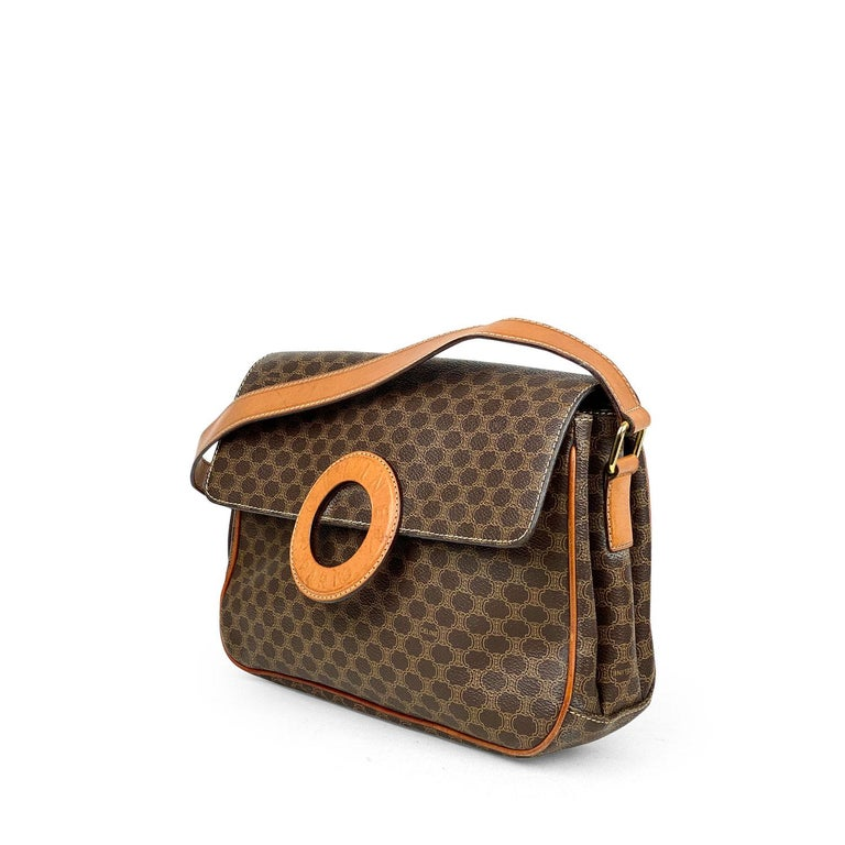 Brown and tan Macadam coated canvas vintage Celine crossbody bag with  – Gold-tone hardware – Single flat detachable shoulder strap – Tan leather lining, three interior pockets and magnetic snap closure at front flap featuring logo