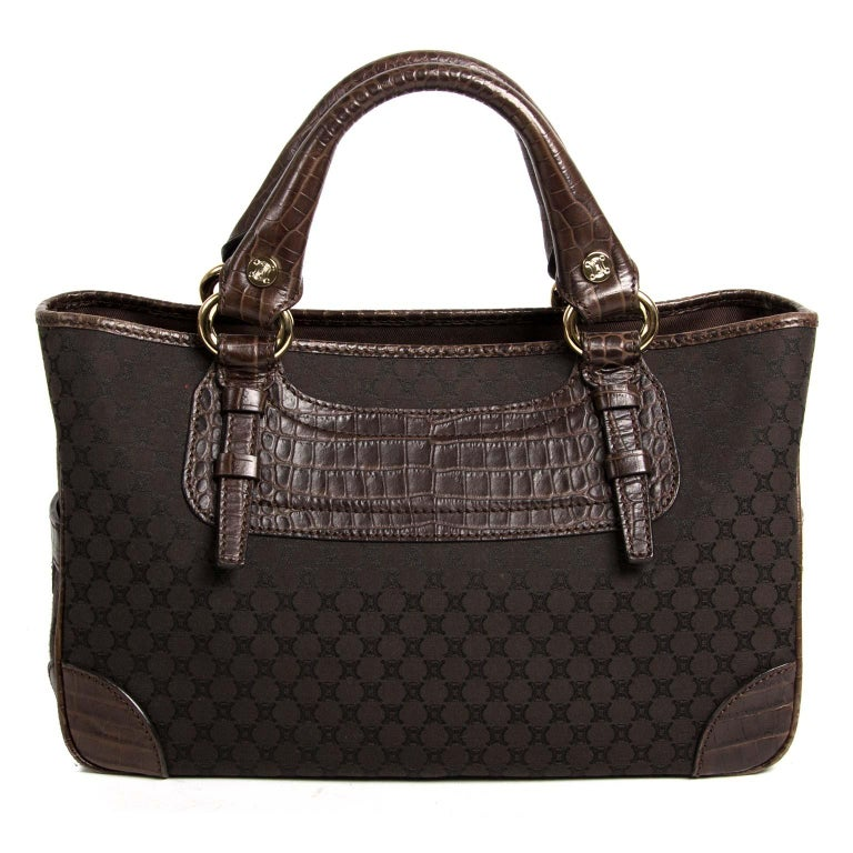 Very good condition  Céline Brown Monogram Boogie Bag  This gorgeous Céline bag is crafted in brown monogram fabric and features brown embossed croco details. It has silver-tone hardware. The bag has two rolled leather handles, perfect to wear in