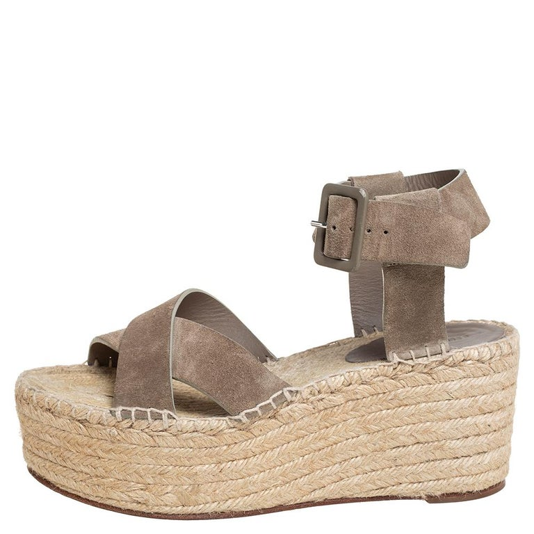 These stunning sandals by Celine are made for a fashionista like you! Crafted from suede in a pretty brown hue, they feature buckle fastening, crossover straps to the front, and 8 cm wedge heels. Wear them with a midi dress to exude a chic
