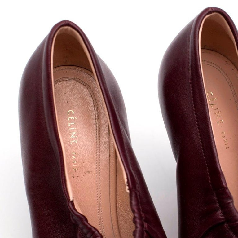 Celine burgundy leather heels with elasticated top and small cone heel.   The heels are made in Italy.   SIZE US/5  Length: 25cm Width: 8cm  Heel Height: 9.5cm  9/10 - Slight wear on the sole. Please refer to images.  Leather