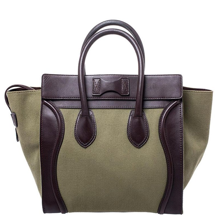 Loved by fashionistas and celebrities, this Tricolor Mini Luggage tote by Celine is a timeless must-have. This tote bag is crafted from the green canvas on the exterior that is accented with burgundy leather. It includes a zip front pocket, double