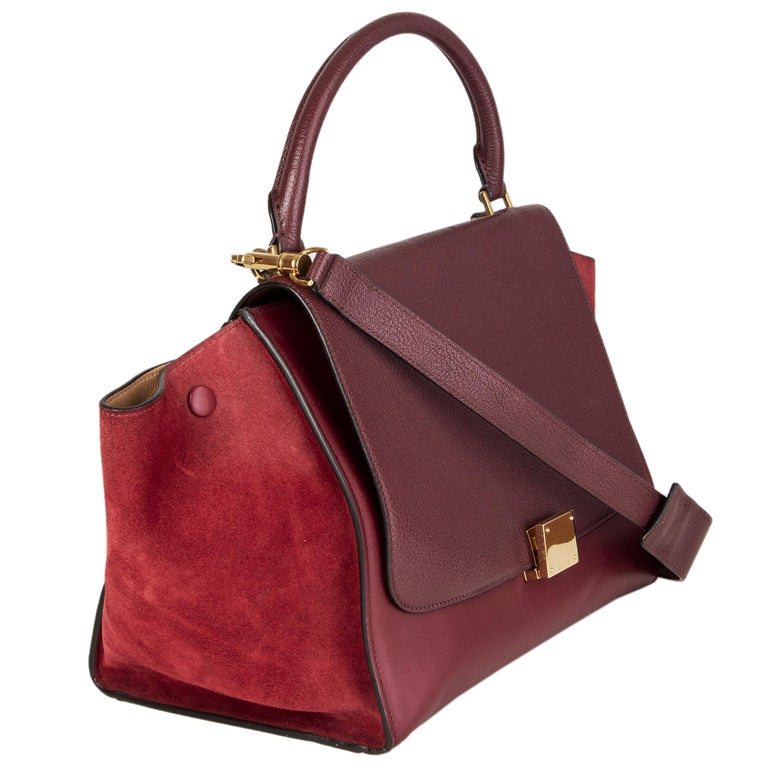 Celine 'Trapeze Small' shoulder bag in burgundy leather and suede with dark burgundy grained leather flap. Zipper pocket on the back. Detachbale shoulder strap. Clsoes with lock and zipper. Lined in beige leather with two open pockets against the