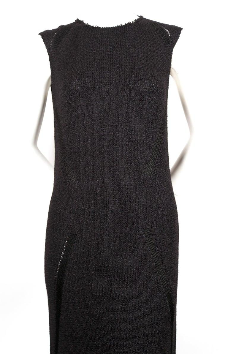 Jet-black, floor length knit dress with raw collar and delicate woven hem designed by Phoebe Philo for Celine. Size S. Approximate measurements: shoulder 13.5