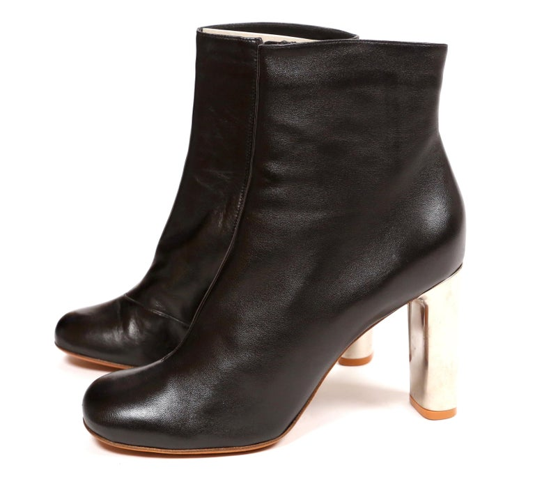 Jet-black, lambskin leather, ankle boots with silver heels designed by Phoebe Philo for Celine. French size 41. Approximate measurements of insoles: length 10.5