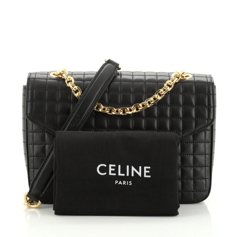 This Celine C Bag Quilted Leather Medium, crafted from black quilted leather, features a sliding chain strap with leather pad and gold-tone hardware. Its clasp closure opens to a black leather interior with three open compartments and side zip and