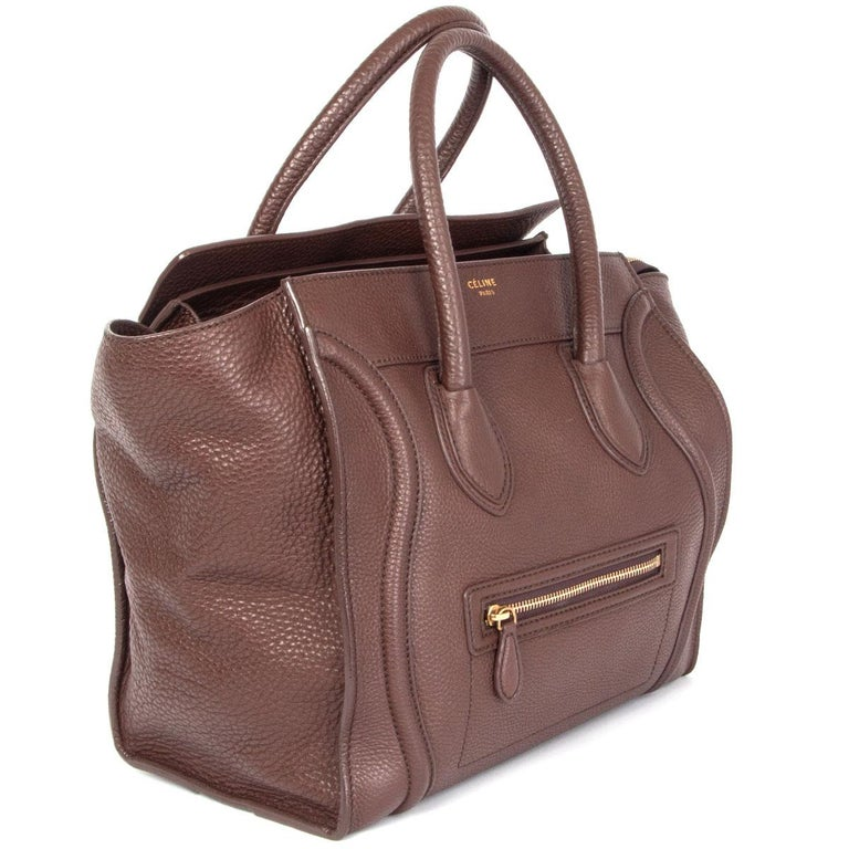 100% authentic Céline Mini Luggage tote bag in chocolate brown grained calfskin. Lined in dark brown microfibre with one zipper pocket against the back and two open pockets against the front. Has been carried and is in excellent condition.
