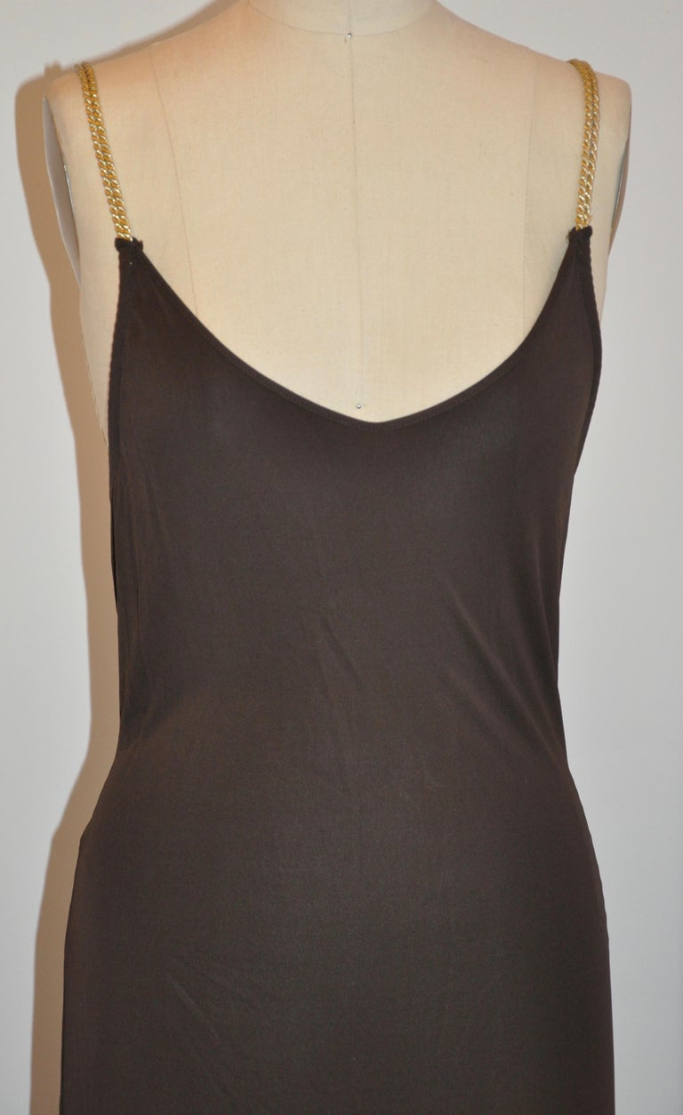Celine woulderful rich coco-brown silk blend jersey low-cut form-fitting maxi dress is slightly flared towards the hemline, which measures 74 inches in circumference. The length measures 54 inches, bust is 36 inches, waist is 28 inches, hips