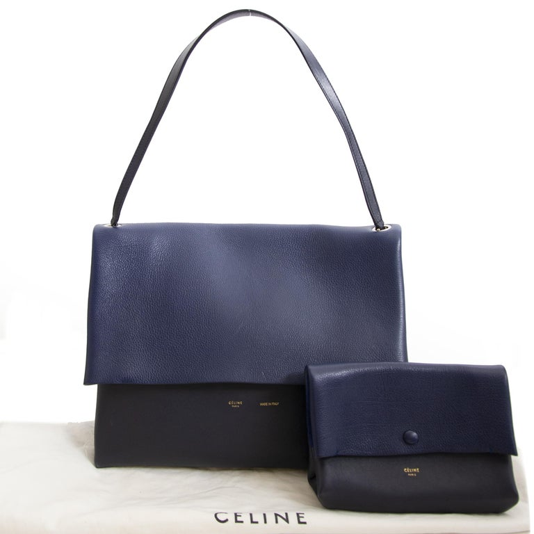 Good condition    Celine Colorblocked Leather Shoulder Bag    Feeling blue? No need to worry because this blue duotoned Celine bag will fill you with joy. It's the perfect bag for a day out because it will fit all our essentials. Combine with a