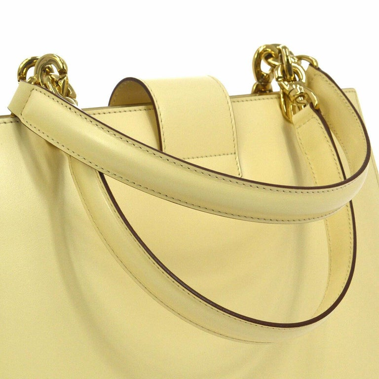 Leather Gold tone hardware Woven lining Toggle turnlock closure Made in Italy Handle drop 6.25