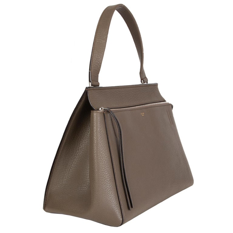 Céline 'Edge Medium' bag in dark khaki calfskin. Opens with a zipper on top and is lined in khaki green leather with two open pockets against the back and one zipper pocket against the front. Has been carried and is in excellent condition. Comes