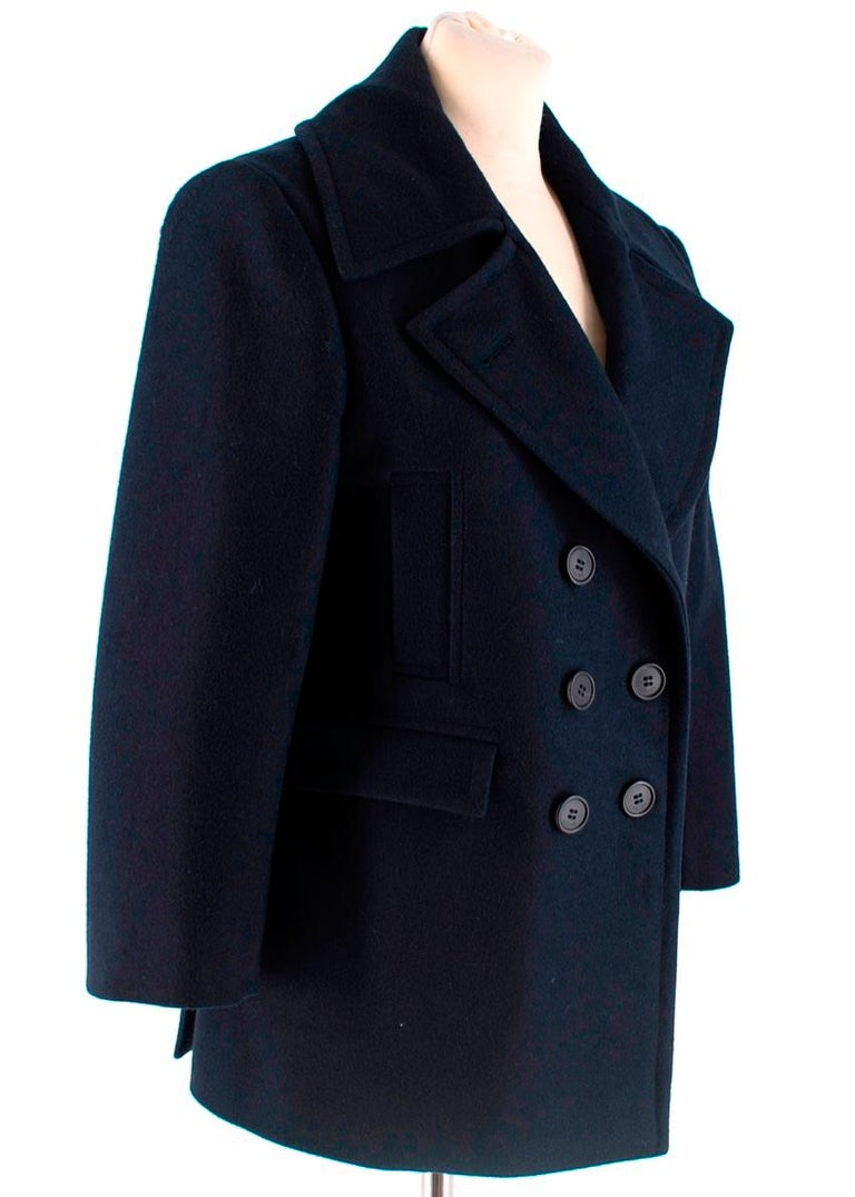 Celine Double Breasted Wool Navy Jacket   -Celine by Phoebe Philo -Made of soft textured wool -Classic straight double breasted cut -Four front pockets -Beautiful navy hue   -Button fastening to the front  -Partially lined  -Branded buttons