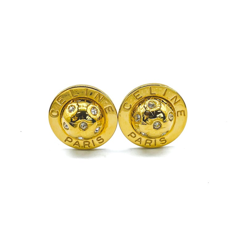 Celine Vintage 1990s Clip On Earrings  Iconic globe statement earrings from the 90s archive  Detail -Made in Italy in the 1990s -Crafted from gold plated metal -Iconic globe design set with rhinestones surrounded by the Celine logo  Size &