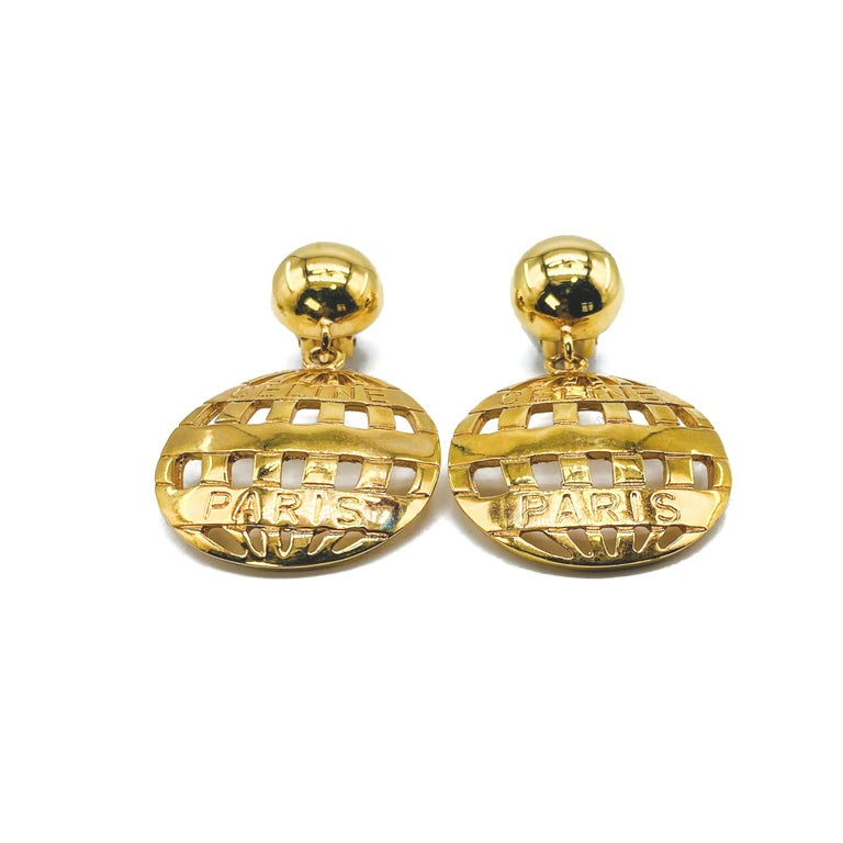 Celine Vintage 1990s Clip On Earrings  Incredible statement drop earrings from the house of Celine  Detail -Made in Italy in the early 1990s  -Crafted from gold plated metal -Embossed with Celine Paris  Size & Fit -Length approx 2.5 inches -Width
