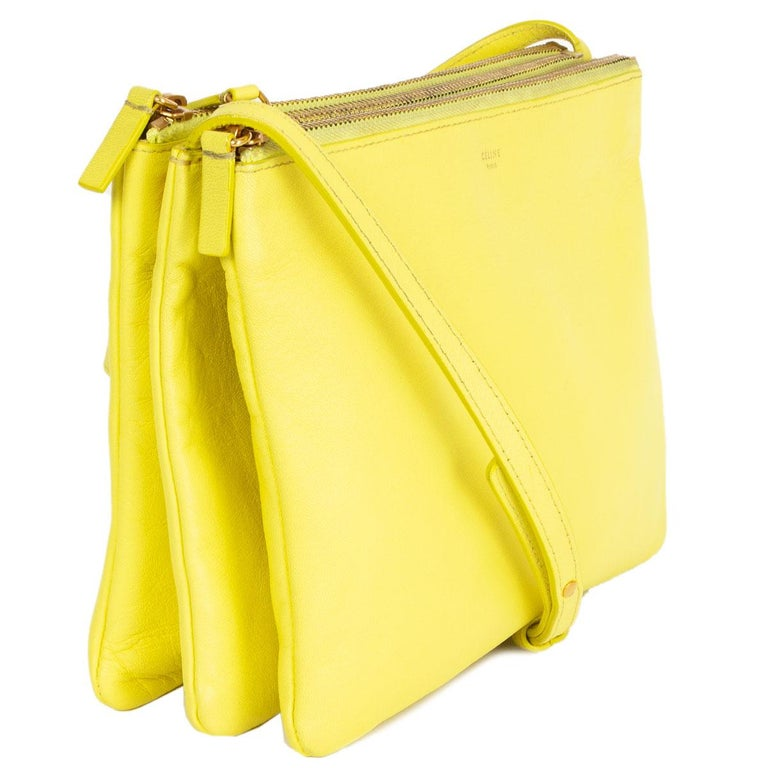 100% authentic Céline Trio Large shoulder bag in fluo yellow lambskin. Can be carried cross-body or on your shoulder. Three separate zipper compartments attached together with snap-buttons. Lined in grey jersey. Can be carried as a clutch by