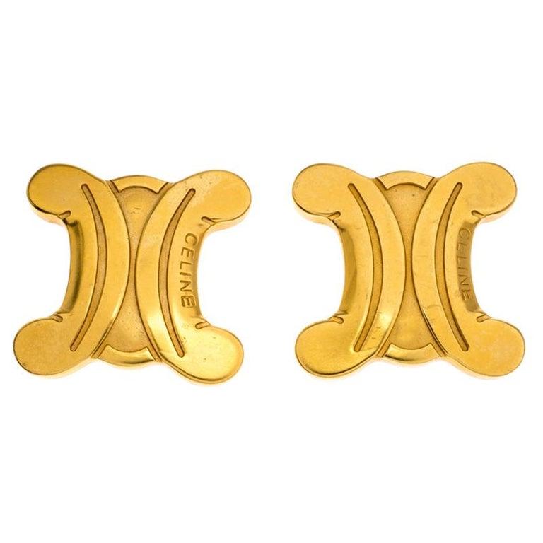 These stud earrings from Celine are sure to brighten your heart. They bring a design of the brand's logo in gold-tone metal enhanced with engravings. The earrings are sure to add the luxury touch on any occasion.  Includes:Original Dustbag