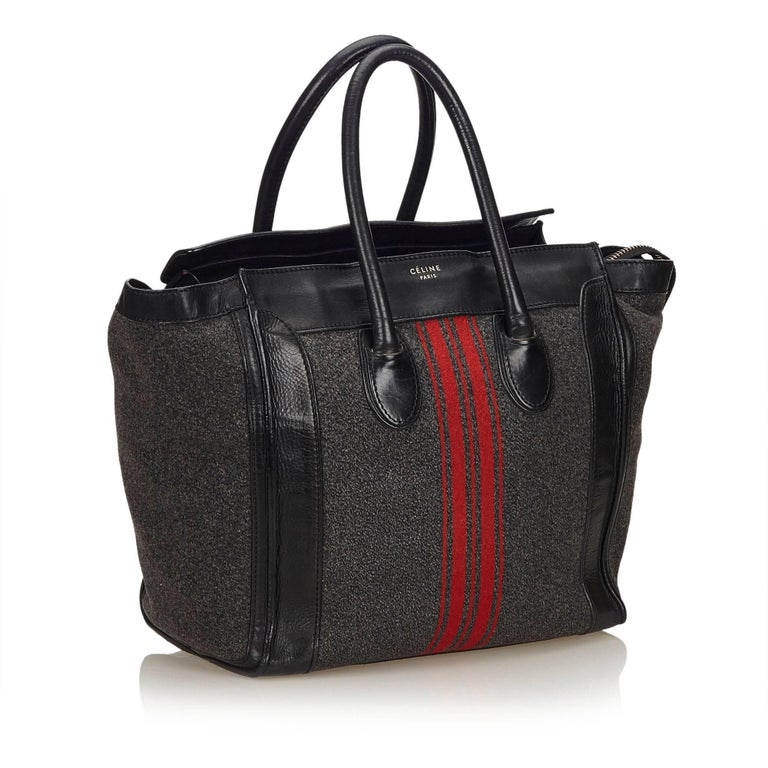 The Medium Luggage features a wool body with leather trim, stripes detail, rolled leather handles, top zip closure, and interior zip pocket.   It carries a B condition rating.  Dimensions:  Length 32 cm Width 29 cm Depth 18 cm Hand Drop 13