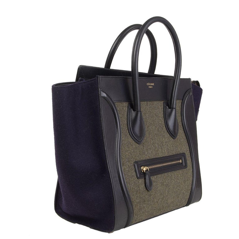 100% authentic Céline 'Mini Luggage' tote in black calfskin and midnight blue and pale olive green felt featuring outer zipper pocket on the front. Lined in black calfskin with one zipper pocket against the back and two open pockets against the