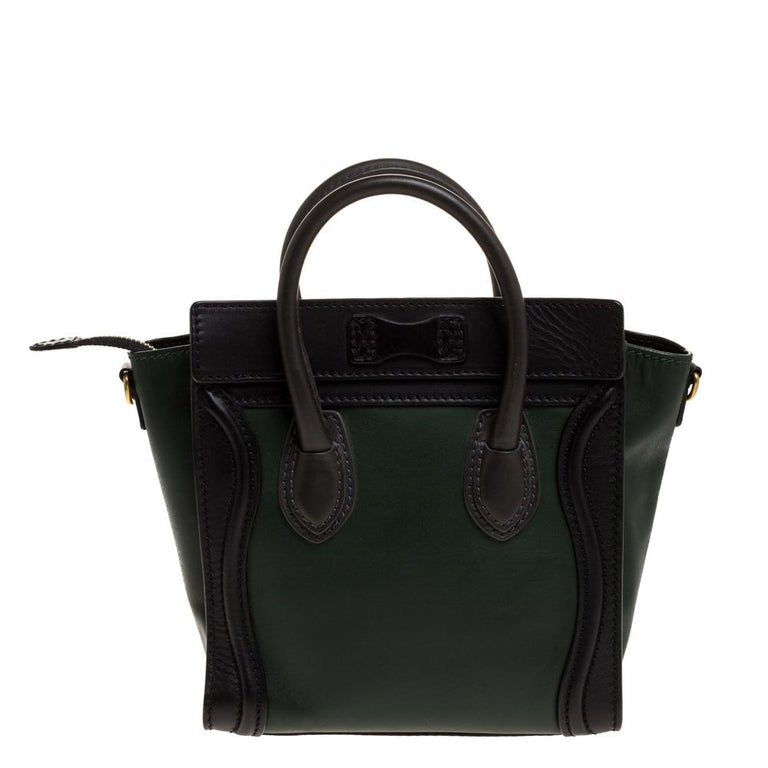 The Nano Luggage tote from Celine is one of the most popular handbags in the world. This tote is crafted from leather and designed in a green shade. It comes with rolled top handles, a detachable shoulder strap, and a front zip pocket. The bag is