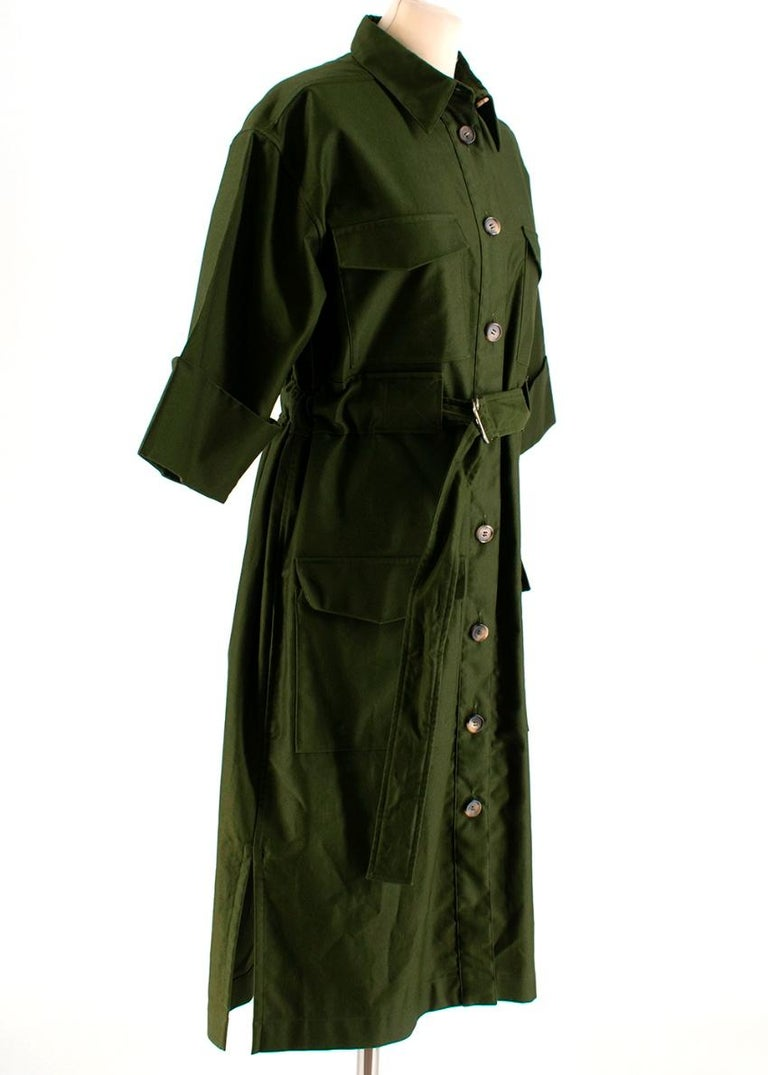 Celine - Green Cotton Utility Dress  - button up front - body shape  - collared - adjustable utility belt at the waist  - four pockets on the front with flap closure  -- splits at the sides - short sleeve - mid weight   - 100% cotton - dry clean