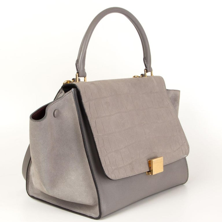 Céline 'Trapeze Medium' shoulder bag in grey calfskin, suede and an crocodile embossed flap. Opens with a zipper on top and is lined in burgundy calfskin with two open pockets against the back. Comes with a detachable shoulder strap. Has been